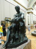 Amazing black statue indoors. Big black statue with lighting on it that gives a silver hue indoors Stock Images