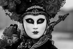 Amazing black and white portrait with venetian mask during venice carnival Royalty Free Stock Photography