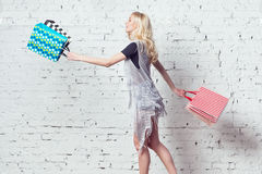Amazing blond girl is going shopping with couple Royalty Free Stock Images