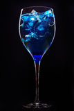 Amazing blue cocktail with ice cubes on dark Royalty Free Stock Photos