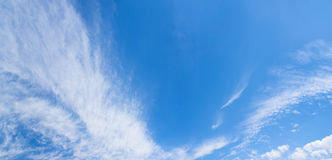 Amazing blue skies. Blue sky and wispy white clouds panorama stock photos