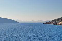 Amazing blue water of Aegean sea near Bodrum. Beautiful landscape of Aegean sea and mountains Photo taken from boat tour in Bodrum, Turkey in october royalty free stock photography