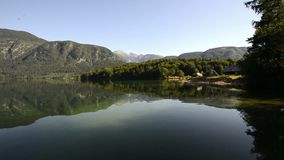 Amazing Bohinj Lake in the morning. Deep clear water with fish and gorgeous landscape of Bohinj valley in Julian Alps. Triglav National Park, Slovenia, Europe stock video