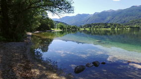 Amazing Bohinj Lake in the morning. Deep clear water with fish and gorgeous landscape of Bohinj valley in Julian Alps. Slovenia. stock video