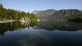 Amazing Bohinj Lake in the morning. Deep clear water with fish and gorgeous landscape of Bohinj valley in Julian Alps. Triglav National Park, Slovenia, Europe stock footage