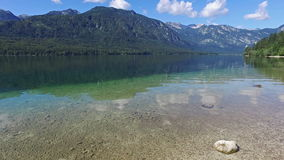 Amazing Bohinj Lake in morning. Deep clear water with fish and gorgeous landscape of Julian Alps. Triglav National Park, Slovenia. stock video