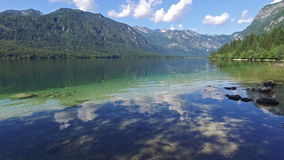 Amazing Bohinj Lake in morning. Deep clear water with fish and gorgeous landscape of Julian Alps. Triglav National Park, Slovenia. stock video footage
