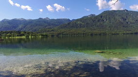 Amazing Bohinj Lake in the morning. Panoramic view. Deep clear water with fish and gorgeous landscape of Bohinj valley. Slovenia. stock footage