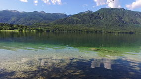 Amazing Bohinj Lake in the morning. Panoramic view. Deep clear water with fish and gorgeous landscape of Bohinj valley. Slovenia. stock video footage