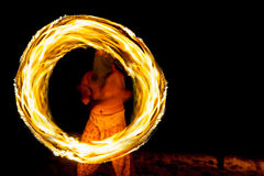 Amazing boy  Fire Show at night on beach Thailand Royalty Free Stock Photo