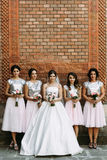 Amazing bride in the bridal dress with the bridesmaids. A Stock Photo