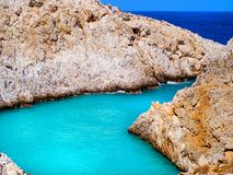 Free Amazing Bright Blue Water In A Secluded Cove With Orange Cliffs Surrounding It - Crete, Greece Stock Photography - 149901682