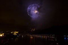 Amazing bright golden and purple firework celebration of the new year 2015 in Prague with the historic city in the background Stock Images