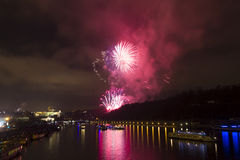 Amazing bright golden and purple firework celebration of the new year 2015 in Prague with the historic city in the background Royalty Free Stock Image