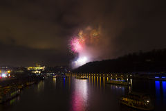 Amazing bright golden and purple firework celebration of the new year 2015 in Prague with the historic city in the background Royalty Free Stock Images