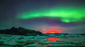 Amazing bright green purple pink orange colored northern lights aurora borealis glow in polar night sky in 4k time lapse stock footage