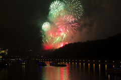 Amazing bright red,yellow,green firework celebration of the new year 2015 in Prague with the historic city in the background Stock Photography