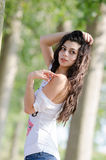 Amazing brunette lady with long curly hair pose outdoor Stock Images