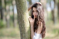 Amazing brunette making the quiet gesture Stock Image