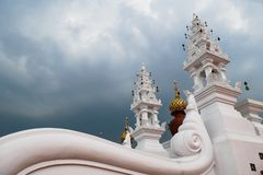 Amazing buddhist architecture with curved white wall with low angle view and beautiful cloudy sky. Amazing curved white wall with low angle view and beautiful royalty free stock photography