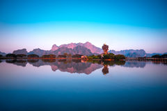 Amazing Buddhist Pagoda in Hpa-An, Myanmar. Amazing Buddhist Kyauk Kalap Pagoda under evening sky. Hpa-An, Myanmar (Burma) travel landscapes and destinations Royalty Free Stock Photography
