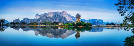 Amazing Buddhist Pagoda in Hpa-An, Myanmar. Amazing Buddhist Kyauk Kalap Pagoda under evening sky. Hpa-An, Myanmar (Burma) travel landscapes and destinations Stock Images