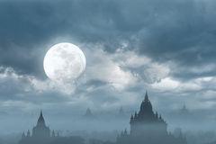 Amazing castle silhouette under moon at mysterious night stock photography