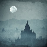 Amazing castle silhouette under moon at mysterious night. Fantasy grunge background in vintage style Stock Photos