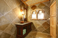 Amazing castle style bathroom with an arch window Stock Photo