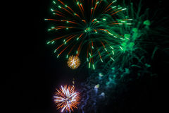 Amazing celebration multicolored sparkling fireworks. 4th of July beautiful fireworks. Independence Day, Canada Day, New Year holidays salute royalty free stock photo
