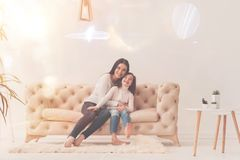 Amazing cheerful mother hugging her daughter stock image