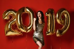 Amazing cheerful stylish woman With Balloons Celebrating New Year`s Eve Party. royalty free stock image