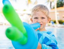 Amazing child plays with balloons stock photography