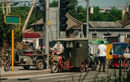 Amazing China, Beijing, street, various working carts on the road royalty free stock image