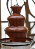 Amazing chocolate fountain. Beautiful restaurant interior table decoration for wedding, chocolate fountain stock image