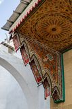 An amazing city in Morocco, Rabat, medina, narrow streets, an incredible-looking canopy over the door. The canopy is painted with an incredible pattern of Royalty Free Stock Photo