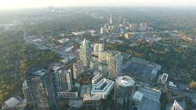 Amazing cityscape of Atlanta downtown skyline in evening sunset in 4k aerial time lapse panorama drone flight stock footage