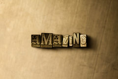 AMAZING - close-up of grungy vintage typeset word on metal backdrop Stock Images