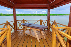 Amazing closeup view of a  wooden made comfortable cozy massage bed inside gazebo Royalty Free Stock Photo