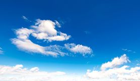 Amazing cloud formations on a blue sky. Amazing cloud formations on a bright blue sky. beautiful cloudscape in summer Royalty Free Stock Photo