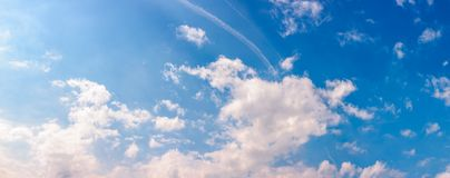Amazing cloud formations on a blue sky. Amazing cloud formations on a bright blue sky. beautiful side lit cloudscape panorama in springtime Royalty Free Stock Images