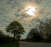 Amazing clouds in a morning road Stock Photography