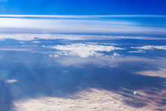 Amazing cloudy sky view from airplane Stock Photos