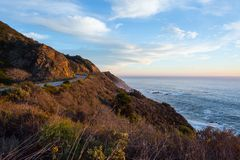 California Route 1,  United States. Amazing coastline of California`s Route 1 with beautiful sky and wavy ocean. California, United States Royalty Free Stock Photo