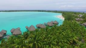Amazing coastline seascape of Bora-Bora tropical clear ocean island French Polynesia in stunning 4k aerial drone view. Amazing coastline seascape of Bora-Bora stock footage