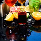 Amazing cocktail recipes. Cocktails garnished with ice cubes, fruit and mint. Fruit liqueur cocktail drinks in glasses. Drink reception. Cocktail party stock images