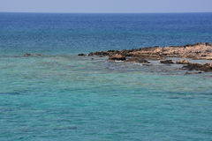Amazing color of the water the Mediterranean Sea, beautiful Crete. Beautiful color of deep blue Crete Sea, Gramvousa island Stock Photos