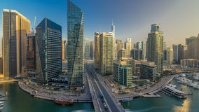 Amazing colorful dubai marina skyline during sunset timelapse. Great perspective of multiple tallest skyscrapers of the world with traffic on the bridge stock video