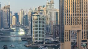 Amazing colorful dubai marina skyline during sunset timelapse. Great perspective of multiple tallest skyscrapers of the world with yachts and boats on canal stock footage