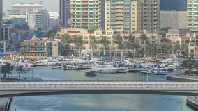 Amazing colorful dubai marina skyline during sunset timelapse. Great perspective of skyscrapers with yachts and boats. Traffic on the bridge. Sunlight over stock footage
